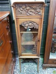Sale 8598 - Lot 1029 - Early 20th Century French Carved Fruitwood Corner Display Cabinet, with arched top, the frieze and glass panel door carved with over...