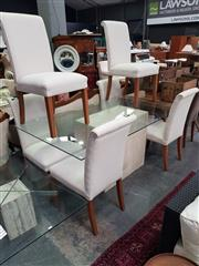 Sale 8672 - Lot 1079 - Seven Piece Dining Setting incl. Glass Top Table on Travertine Base & Six Cream Upholstered Chairs