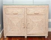 Sale 8904H - Lot 14 - A two door two drawer bedside cabinet, woven clad with drop handles. Height 81cm x Width 110cm x Depth 40cm