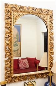 Sale 8882H - Lot 100 - A florentine carved moulded and gilt mirror with arch top and floral spandrels, Height approx 119cm x 86cm