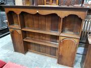 Sale 8959 - Lot 1007 - Georgian Style Oak Dresser Top, with shaped frieze, open shelves flanked by two arched top cupboards (base moulding needs re-attachi...