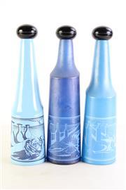 Sale 8963 - Lot 12 - Set of three Salvador Dali blue glass decanters (N.1, 2 & 3), H34cm