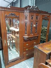 Sale 8728 - Lot 1008 - Late Victorian Carved Walnut Breakfront Wardrobe, with bow front double door section, above five drawers & flanked by two long doors