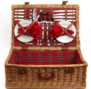 Sale 9071F - Lot 25 - A CANE PICNIC BASKET; including a setting for four persons, lined with tartan material and fastening with leather clips and handle.