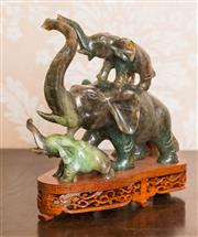 Sale 8375A - Lot 18 - Carved hardstone figural group of an elephant family on a stand. Height: 16cm.