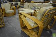 Sale 8287 - Lot 1057 - Pretzel Cane Four Piece Lounge Suite incl. Four Seater & Two Armchairs & Ottoman