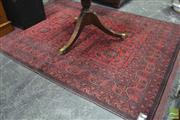 Sale 8345 - Lot 1033 - Afghan Khal Wool Carpet, with six medallions, in red & black tones (199 x 150cm)