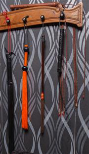 Sale 8761A - Lot 74 - A group of long whips including PVC, orange rubber, leather and plaited (5)