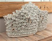 Sale 8904H - Lot 9 - A large ceramic organic form sculpture in the shape of two baskets with barnacles.