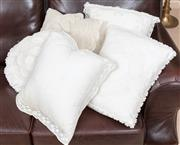Sale 8926K - Lot 51 - A group of five white embroidered and stitched cushions