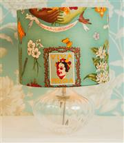 Sale 8448A - Lot 12 - Frida Khalo table lamp with Frida Khalo print drum shade on clear globular glass base Condition: New Measurements: 35cm overall...