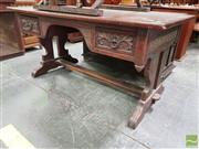 Sale 8485 - Lot 1059 - South American Spanish Colonial Carved Oak Desk, with two drawers, end supports & stretcher