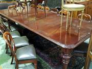 Sale 8653 - Lot 1079 - Victorian Mahogany Extension Dining Table, with three later leaves, raised on turned legs with lense decoration (restored/ winder in...