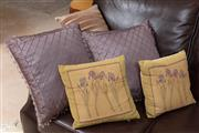 Sale 8926K - Lot 50 - Five coloured fabric cushions, two featuring Iris