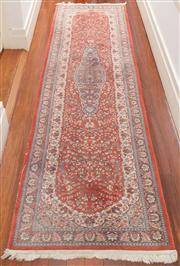 Sale 8575H - Lot 35 - A Persian runner with central elongated medallion, on a red ground 315 x 82cm