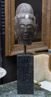 Sale 8746 - Lot 1037 - A Chinese carved stone head possibly of Guanyin, with hair swept up and with floral tiara, mounted on a black granite stand (chip to...