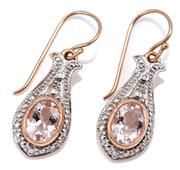 Sale 9083 - Lot 374 - A PAIR OF EDWARDIAN STYLE MORGANITE AND DIAMOND EARRINGS; 9ct rose gold tapered drops each with rhodium plated top rub set with an o...