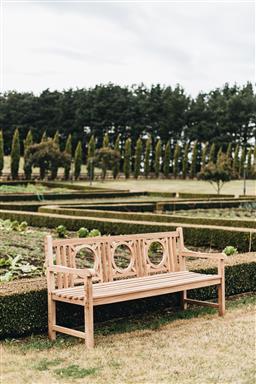 Sale 9200P - Lot 45 - A long teak bench, Height 90cm x  Length 180cm x Depth 63cm