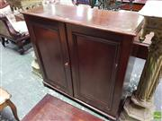 Sale 8559 - Lot 1014 - An Early Cedar Cabinet, with two panel doors revealing three shelves