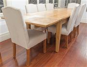 Sale 8575H - Lot 36 - A contemporary light oak extension dining table, seats 8-14, with two end extension panels, on tapered legs H: 77cm W: 100cm L...