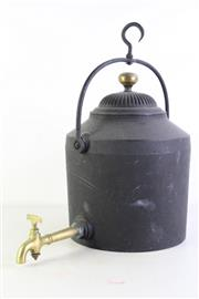Sale 8926K - Lot 91 - A cast iron hearth kettle with brass spigget, H 47cm