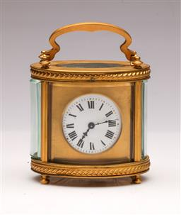 Sale 9104 - Lot 24 - A Brass Cased Carriage Clock (H 11cm)