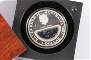 Sale 9010 - Lot 83 - A Queen Elizabeth II (2007) 1 oz pure silver Dollar Treasures of Australia with Sapphire Inserts by The Perth Mint, coin no.4289/7500