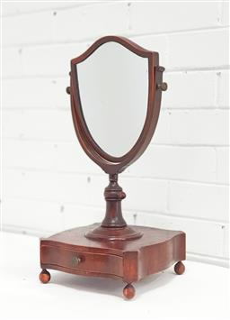 Sale 9142 - Lot 1086 - 19th Century Mahogany Shaving Stand, in the Georgian manner, the shield shaped mirror on adjustable wooden pole, the square serpenti...