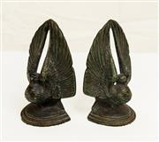 Sale 8439A - Lot 83 - A pair of heavy patinated metal bookends in the form of doves with elevated wings, H 17cm