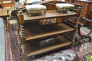 Sale 8390 - Lot 1009 - A Victorian Oak Dumbwaiter of three tiers with barley twist supports and brass wagon wheel castors.