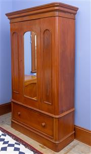 Sale 8649A - Lot 39 - A late C19th kauri pine wardrobe with central mirror panelled door flanked by two blind panels with a long drawer below, H 200 x W 1...