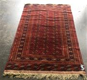 Sale 8868 - Lot 1112 - Royal Bokhara Wool Carpet, with three columns of guls in red (193 x 124cm)