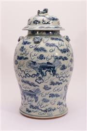 Sale 9015C - Lot 797 - A Blue and White Lidded Chinese Jar Featuring Lions Amongst Clouds (H 44cm, Repair to Lid)