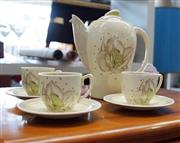 Sale 8320 - Lot 806 - Susie Cooper tea set with 3 cups and saucers circa 1935