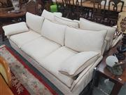 Sale 8672 - Lot 1085 - Pair of Cream Three-Seater Sofas