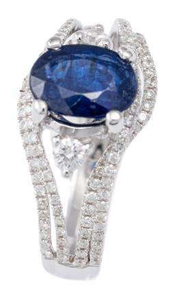 Sale 9124 - Lot 393 - AN 18CT WHITE GOLD KYANITE AND DIAMOND RING;  centre bead claw set with an oval cut kyanite of approx. 1.40ct (wear) between 2 round...