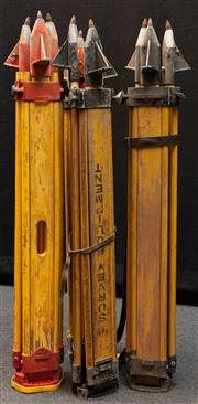 Sale 8984W - Lot 554 - A group of four surveyors tripods in predominantly timber with metal spikes. Approx height 108cm