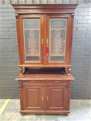 Sale 9031 - Lot 1080 - Early 20th Century French Walnut Buffet a Deux Corps, the two upper glass panel doors etched with trophies of the arts, with two dra...