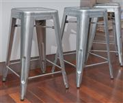 Sale 8575H - Lot 42 - Four Tolix-style silver powder-coated stools H: 66cm