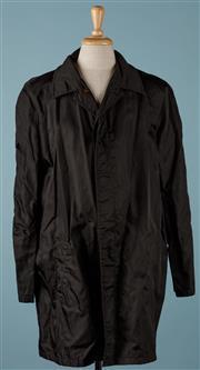 Sale 9080F - Lot 5 - A PRADA RAIN JACKET; in black with internal pockets, Size XXL