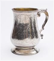 Sale 8590A - Lot 6 - A Victorian sterling silver baluster shaped mug with engraved scroll work and partial gilt interior, London 1878,  Height 13cm, 310g.