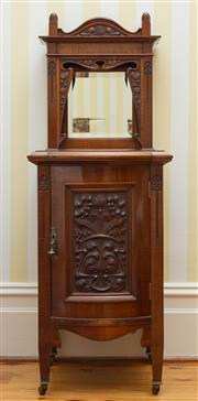 Sale 8649A - Lot 52 - A Federation fiddle back blackwood pot stand/bedside cabinet, alcove back with mirror above a bowfront carved panel, marked Farmer &...