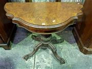 Sale 8653 - Lot 1090 - Victorian Burr Walnut Card Table, the shaped demi-lune top, on turned lens carved pedestal, on outswept legs