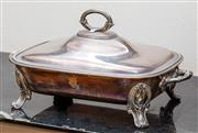 Sale 8882H - Lot 42 - A Victorian silver plated warming dish with hinged cover and gryphon armorial, Length 30cm