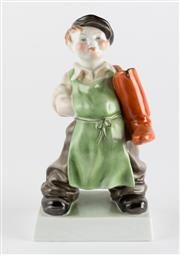 Sale 8518A - Lot 66 - A vintage Hungarian Herend porcelain figure of a cobblers lad with a pair of huge red boots slung over 1 shoulder.  Ht: 20cm
