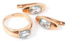 Sale 9149 - Lot 308 - A RUSSIAN 14CT GOLD TOPAZ RING AND EARRINGS SUITE; each set with an oval cut blue topaz, ring size N, boat shaped earrings with cont...