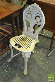Sale 8345 - Lot 1087 - Victorian Coalbrookdale Cast Iron Garden Chair, with pierced back & seat, on three legs joined by stretchers, impressed name to back