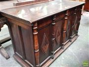 Sale 8485 - Lot 1057 - 17th Century Style Oak Panelled Coffer, with hinged lid, the front with diamonds & turned columns