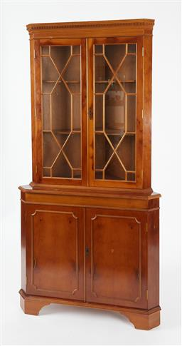 Sale 9123J - Lot 43 - A vintage English pale elm and ash Georgian style corner cabinet C: 1960. The dentil cornice above a pair of glazed quarrelled doors...