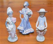 Sale 8368A - Lot 44 - Three Lladro figures of girls carrying flowers, tallest 30 cm
